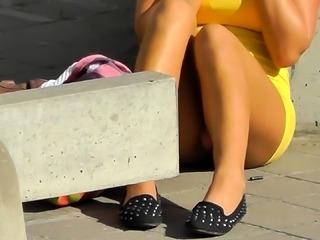 Slender amateur teen with sexy legs reveals her pink panties