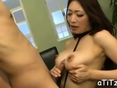 Japanese sweetheart with massive tits rides on a fake penis