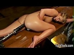 Busty babe stuffed by massive dildo