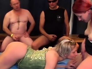 Slut sucking in gang bang