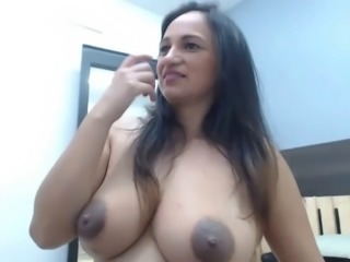 Latin slut showing big tits and dark nipples freely on cam