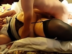 Fat mature lady in black lingerie gets shared by two guys