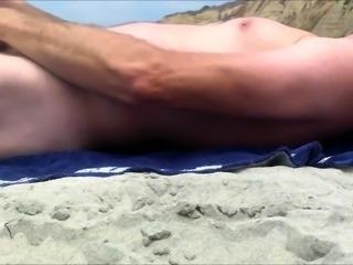 Beach voyeur follows a hot amateur babe with a lovely ass