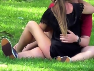 Cute amateur teen sits on top of her boyfriend in the park