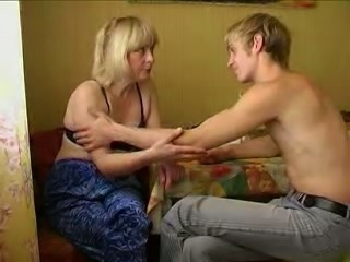Chubby blonde mom fucks a young dude in the kitchen