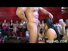 Cute darling is riding on knob wildly during lusty show