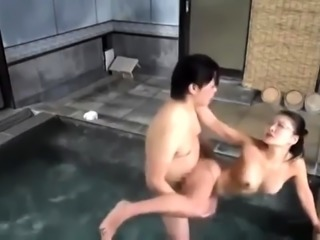 Bodacious Japanese wife has sex with her lover by the pool