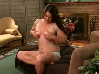 Plump hairy brunette puts on a show