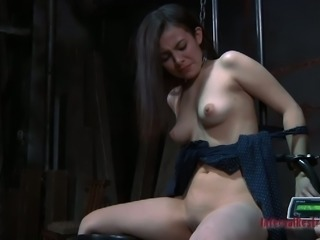 Brunette Lorna is fucked brutally with a special tool