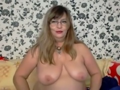 Chubby mature lady plays with her cunt during a private webcam show