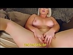Busty blonde loves squeezing her boobs
