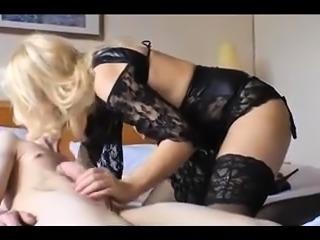 Glamour blonde lingerie tease in fishnet stockings