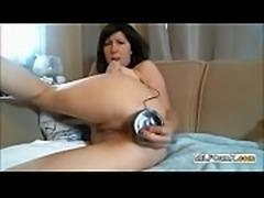 Webcam MILF Shoves A Huge Black Dildo In Her Ass