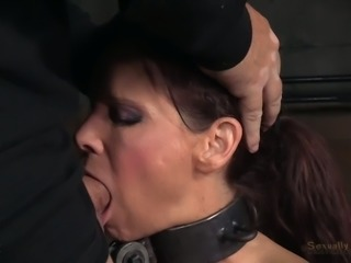 Submissive and busty brunette housewife shackled and facefucked