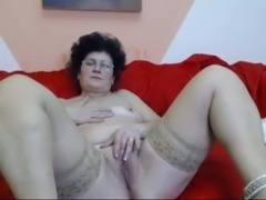 My old wife strips in front of a webcam and fingers her cunt
