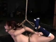 Young slave hogtied while toying her pussy