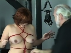 Naked woman extraordinary bondage at home with stud