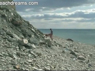 Chubby nudist is getting banged brutally in a doggy position on a beach