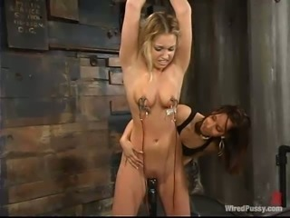 Hollie Stevens gets chained and fucked hard by Isis Love