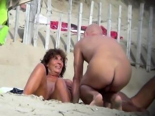 Public beach sex of a voyeur horny couple