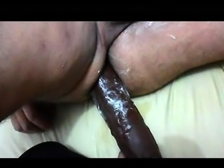Amateur wife plowing her husband's ass with big sex toys