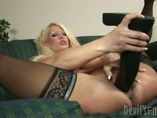 Saucy blond bombshell fucks her kitty with giant fake cocks hard