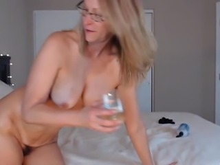 Older women with a big ass ride a huge black dildo