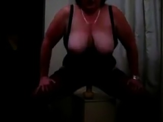 Buxom mature BBW wife rides ten inch long dildo for me