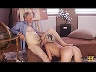 OLD4K. Old man with beard actively stretches young blonde on daybed