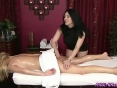 Fake-boobed blonde gets her body massaged by brunette lesbian