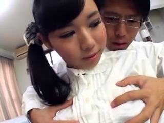 Japanese beauty gets her moist large tits groped and licked