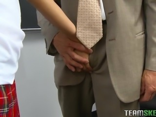 brunette student getting naughty with her teacher at school