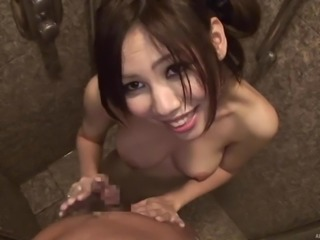 After a shower the Japanese girl fucks in the hotel bed