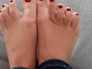 Red nails and beautiful feet