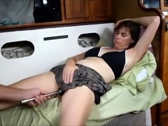 Lustful mature brunette has a sex toy making her pussy wet