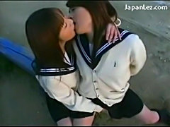 Schoolgirl in uniform kissing passionately getting her pussy free