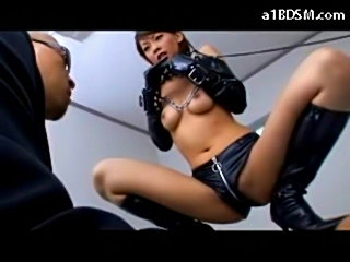 Slave asian girl in pvc outfit tied arms rubbed with stick s free