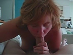 Classy mature businesswoman teasing and sucking cock