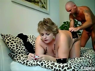 this fatty gets it from behind as she smokes and lets her hubby do her good