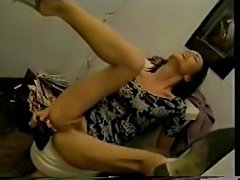 Girl fucks herself with a toilet brush before stucking a huge plunger in her...