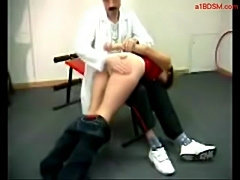 Girl laying on a doctor lap getting her ass spanked to red  free