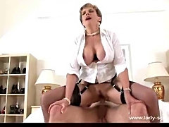 Stockings milf giving head and sitting on dick
