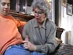 Granny helps out grandson on his jerking off
