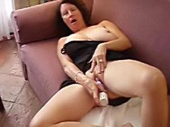 Sexy Aunt Sally masturbates on camera