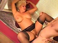 Slutty mature blonde in lingerie craves his dick