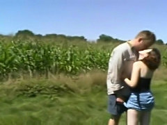 Out in the cornfield a horny couple treat an old perve to a fine time