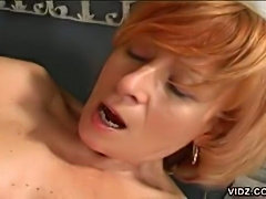 Mature blonde bitch satisfies pussy