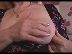 Attractive busty granny and teases then shows off her hairy plump