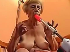 Grandma sucks her dildo machine