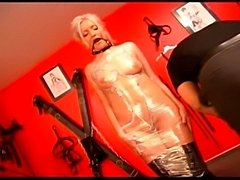 Sweet fem dom and willing slaves collude in this Germanfetish feature. Clothespins clamped on a pussy arepulled open for you to view a big clit. Flogged baremale ass turns beet red, fully wrapped femalesubmissive...all for your viewing pleasure